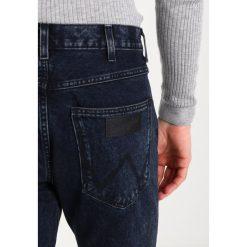Wrangler SPENCER Jeansy Slim Fit blue black. Szare jeansy męskie relaxed fit marki Wrangler, l, z poliesteru, z kapturem. W wyprzedaży za 296,10 zł.