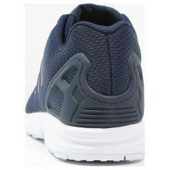Adidas Originals ZX FLUX Tenisówki i Trampki new navy/running white. Niebieskie tenisówki damskie marki adidas Originals, z materiału. W wyprzedaży za 174,50 zł.