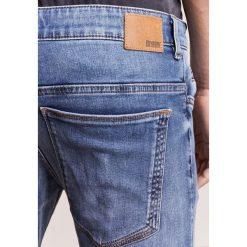 DRYKORN JAZ Jeansy Slim Fit blue. Niebieskie jeansy męskie relaxed fit marki DRYKORN, m, z dekoltem karo. Za 629,00 zł.