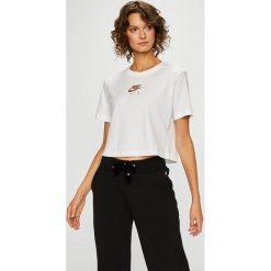 Nike Sportswear - Top. Szare topy damskie Nike Sportswear, l, z nadrukiem, z bawełny, z okrągłym kołnierzem. W wyprzedaży za 99,90 zł.