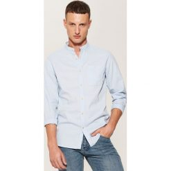 Koszula ze stójką - Niebieski. Czarne koszule męskie na spinki marki KIPSTA, z poliesteru, do piłki nożnej. Za 89,99 zł.