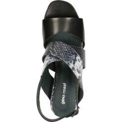 Sandały HANA. Czarne sandały trekkingowe damskie marki Gino Rossi, z motywem zwierzęcym, ze skóry, na koturnie. Za 199,90 zł.