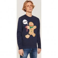 Bluza ze świąteczną aplikacją - Granatowy. Niebieskie bluzy męskie marki House, l, z aplikacjami. Za 89,99 zł.