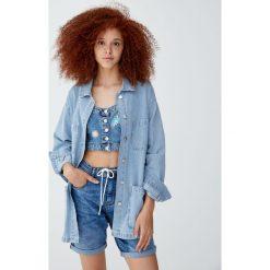 Kurtka jeansowa worker w paski. Niebieskie kurtki damskie jeansowe Pull&Bear, w paski. Za 139,00 zł.