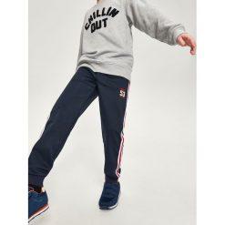 Odzież dziecięca: Spodnie dresowe z lampasami - Granatowy