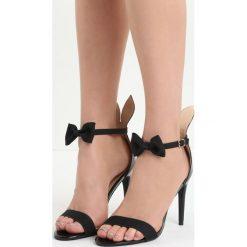 Czarne Sandały Rabbit. Czarne sandały damskie marki Born2be, w paski, na wysokim obcasie, na szpilce. Za 59,99 zł.