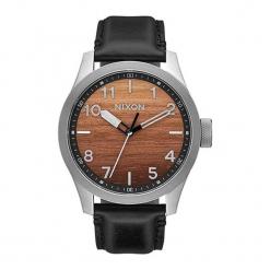 """Zegarek """"A975-2457-00"""" w kolorze czarno-srebrno-brązowym. Brązowe, analogowe zegarki męskie NIXON & ESPRIT, ze stali. W wyprzedaży za 629,95 zł."""