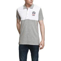 Koszulka polo w kolorze szaro-białym. Białe koszulki polo Camel Active, Varsity, l. W wyprzedaży za 72,95 zł.