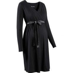 Sukienka ciążowa i do karmienia bonprix czarny. Czarne sukienki ciążowe bonprix, z satyny, z dekoltem w serek, moda ciążowa. Za 109,99 zł.