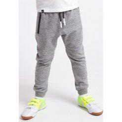 Chinosy chłopięce: Spodnie dresowe dla małych chłopców JSPMD100 - średni szary melanż