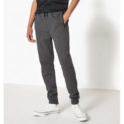 Spodnie typu jogpant 10-16 lat. Szare spodnie chłopięce La Redoute Collections, z bawełny. Za 96,98 zł.