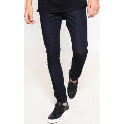 Nudie Jeans LIN Jeans Skinny Fit dry deep orange. Czarne jeansy męskie relaxed fit marki Criminal Damage. Za 459,00 zł.
