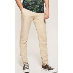 Spodnie męskie: Spodnie typu jogger z domieszką lnu – Beżowy