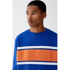 Bluza z panelem. Niebieskie bluzy męskie rozpinane Pull&Bear, m. Za 79,90 zł.