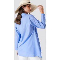 Trendyol Asymetryczna tunika z rozcięciami - Blue. Niebieskie tuniki damskie z długim rękawem Trendyol, z asymetrycznym kołnierzem. W wyprzedaży za 70,98 zł.