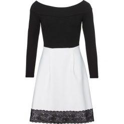 Sukienka bonprix czarno-biały. Czarne sukienki koronkowe marki bonprix, w koronkowe wzory. Za 149,99 zł.
