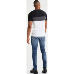 GStar 3301 DESCONSTRUCTED SUPER SLIM Jeans Skinny Fit medium indigo aged. Niebieskie jeansy męskie relaxed fit G-Star. Za 469,00 zł.