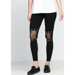 Czarne Legginsy Inset. Czarne legginsy marki House, z jeansu, z podwyższonym stanem. Za 39,99 zł.