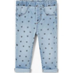 Mango Kids - Jeansy dziecięce Nora 80-98 cm. Niebieskie rurki dziewczęce Mango Kids, z bawełny. W wyprzedaży za 49,90 zł.