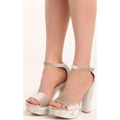 Beżowe Sandały Erisa. Brązowe sandały damskie na słupku Born2be, z materiału, na wysokim obcasie. Za 79,99 zł.