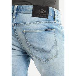 Superdry Jeans Skinny Fit highway blue. Niebieskie rurki męskie Superdry. W wyprzedaży za 343,20 zł.