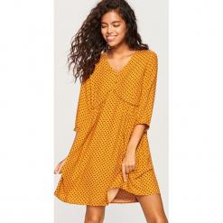 Sukienka we wzory - Żółty. Żółte sukienki marki Reserved. Za 99,99 zł.