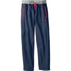 Spodnie dresowe Regular Fit bonprix ciemnoniebieski. Niebieskie spodnie dresowe męskie marki Geographical Norway, z aplikacjami, z dresówki. Za 69,99 zł.
