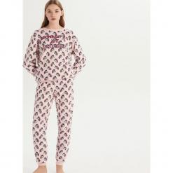 Pluszowa piżama w jednorożce - Różowy. Czerwone piżamy damskie marki Sinsay, l. Za 79,99 zł.