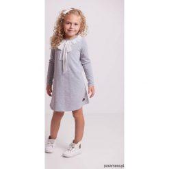Sukienki dziewczęce dzianinowe: Trapezowa sukienka z falbanką