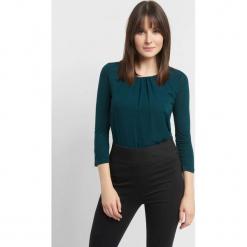 Koszulka z zakładkami. Czarne bluzki longsleeves marki Orsay, xs, z bawełny, z dekoltem na plecach. Za 59,99 zł.