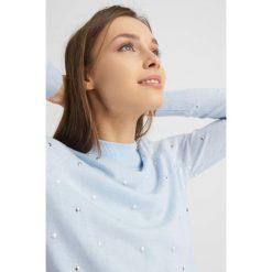 Odzież damska: Sweter z koralikami