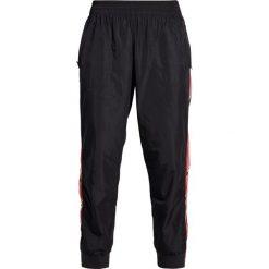 Bryczesy damskie: adidas by Stella McCartney TRAIN Spodnie treningowe dark grey