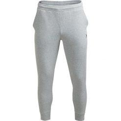 Spodnie dresowe męskie SPMD600 - ŚREDNI SZARY MELANŻ - Outhorn. Szare spodnie dresowe męskie Outhorn, na jesień, melanż, z dresówki. W wyprzedaży za 48,99 zł.
