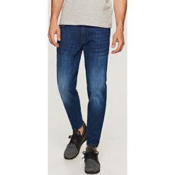 Jeansy carrot - Granatowy. Niebieskie jeansy męskie marki QUECHUA, m, z elastanu. W wyprzedaży za 69,99 zł.