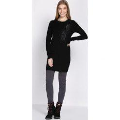 Czarna Sukienka Unclouded. Czarne sukienki dzianinowe Born2be, l. Za 59,99 zł.