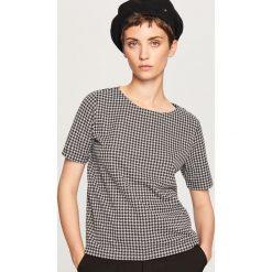 Pudełkowy t-shirt we wzory - Czarny. Białe t-shirty damskie marki Reserved, l, z dzianiny. Za 49,99 zł.