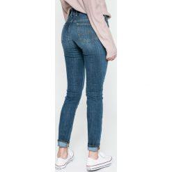Mustang - Jeansy Gina Jeggins. Niebieskie jeansy damskie rurki marki Mustang, z obniżonym stanem. W wyprzedaży za 199,90 zł.