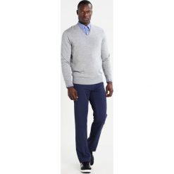 Polo Ralph Lauren Golf Sweter light grey heather. Szare golfy męskie marki Polo Ralph Lauren Golf, l, z materiału. W wyprzedaży za 419,25 zł.