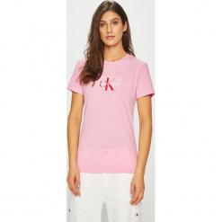 Calvin Klein Jeans - Top Monogram. Niebieskie topy damskie marki DOMYOS, z elastanu, street, z okrągłym kołnierzem. Za 229,90 zł.