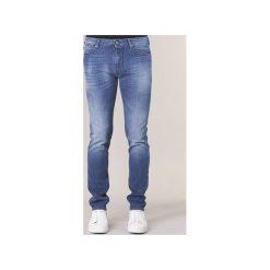 Jeansy slim fit Emporio Armani  BREWUTE. Szare jeansy męskie relaxed fit marki Emporio Armani, l, z bawełny, z kapturem. Za 615,20 zł.
