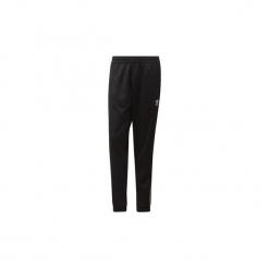 Spodnie treningowe adidas  Spodnie dresowe Pharrell Williams SST. Czarne spodnie dresowe męskie Adidas, z dresówki. Za 379,00 zł.