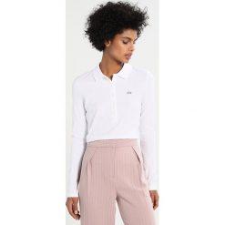 Lacoste Koszulka polo white. Białe bluzki asymetryczne Lacoste, z bawełny, polo, z długim rękawem. Za 449,00 zł.
