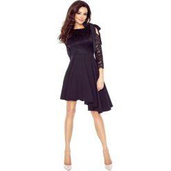 NATALIA  asymetryczna sukienka z koronkową górą CZARNA. Czarne długie sukienki Bergamo, w koronkowe wzory, z koronki, eleganckie, z asymetrycznym kołnierzem, z długim rękawem, asymetryczne. Za 259,99 zł.