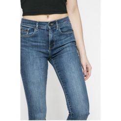 Calvin Klein Jeans - Jeansy WONDER MID. Niebieskie jeansy damskie marki Calvin Klein Jeans, z aplikacjami, z bawełny. W wyprzedaży za 299,90 zł.