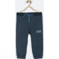 Spodnie. Niebieskie spodnie chłopięce GRIZZLY BEAR, z bawełny. Za 79,90 zł.