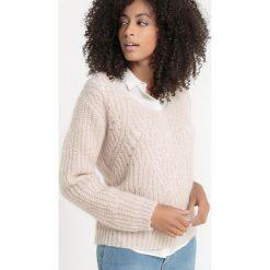 Sweter z dekoltem w kształcie litery V z ozdobnej dzianiny. Białe kardigany damskie La Redoute Collections, z dzianiny. Za 188,96 zł.
