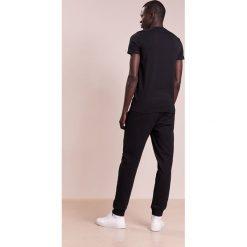 Spodnie męskie: Emporio Armani JOGGER Spodnie treningowe nero