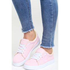 Różowe Buty Sportowe The Space. Czerwone buty sportowe damskie marki KALENJI, z gumy. Za 59,99 zł.