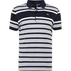 J.LINDEBERG RALFS STRIPED SLIM TX  Koszulka sportowa navy. Niebieskie koszulki sportowe męskie J.LINDEBERG, m, z materiału. Za 379,00 zł.