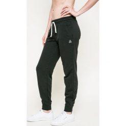 Reebok - Spodnie. Szare spodnie sportowe damskie Reebok, m, z bawełny. W wyprzedaży za 129,90 zł.